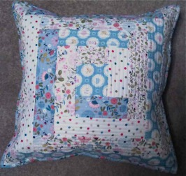 Log Cabin Cushion By Sarah Wellfair