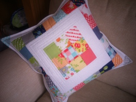 Mini charm pack cushion by Sarah Wellfair